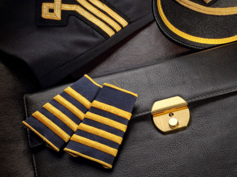 What do the stripes on a pilot's uniform mean?